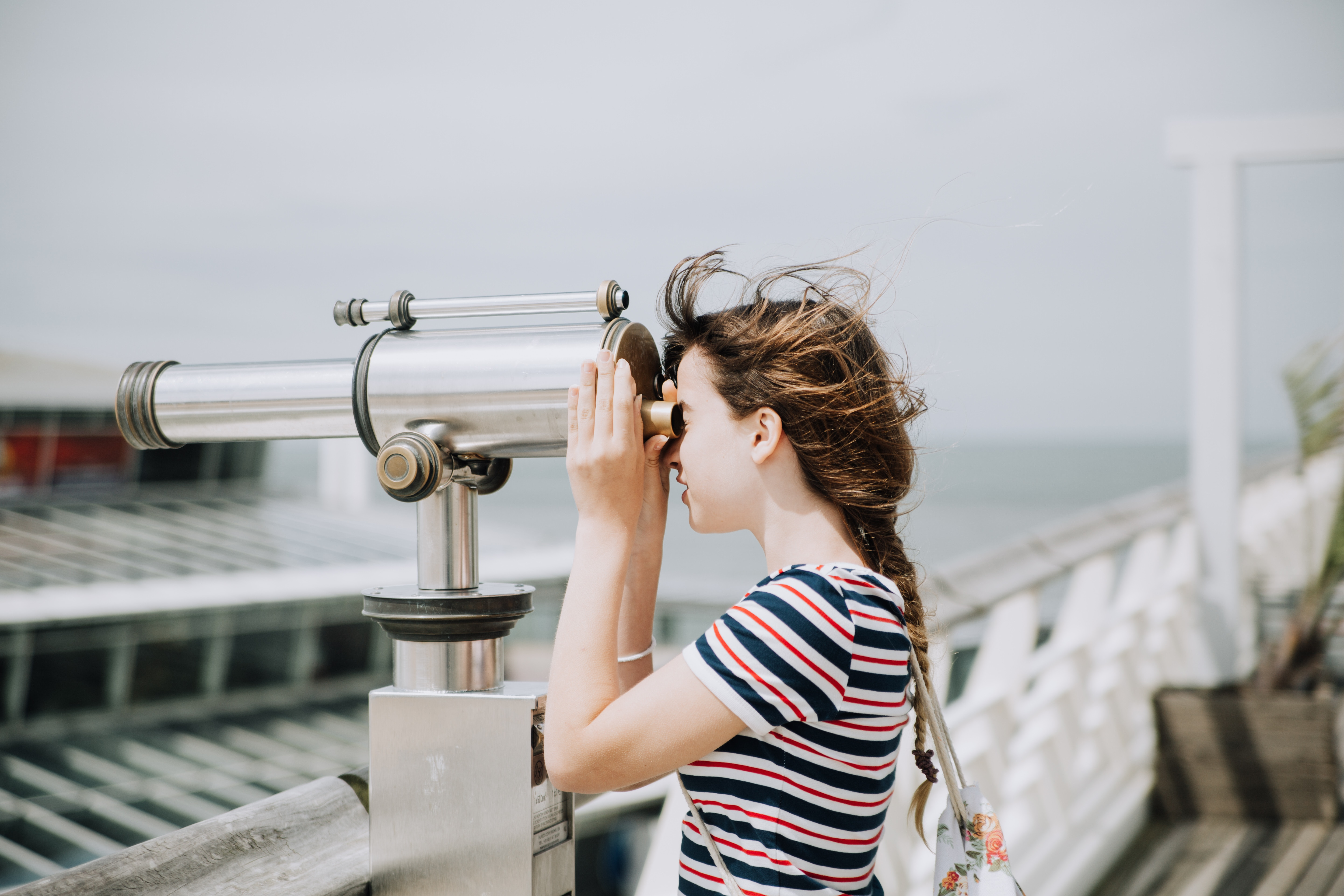 a girl looking into a telescope